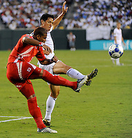 Roman Torres (5) of Panama clears the ball away from Brian Ching (11) of the United States (USA). The United States (USA) defeated Panama (PAN) 2-1 during a quarterfinal match of the CONCACAF Gold Cup at Lincoln Financial Field in Philadelphia, PA, on July 18, 2009.