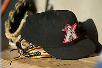 A Kannapolis Intimidators hat lies on top of a glove on the bench in a recent game versus Asheville at Fieldcrest Cannon Stadium in Kannapolis, NC, Sunday, April 29, 2007.