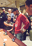 Nanad Medic shakes Daniel Negreanu's hand.  Medic cracked Kid Poker's Aces to eliminate him.