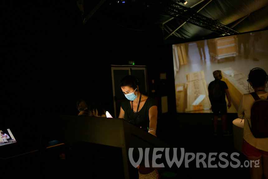"LISBON, PORTUGAL - MAY 31: A visitor its seen using a touch screen the ""Meet Vicent Van Gogh"" exhibition as the spread of the (COVID-19) continues in Lisbon, on May 31, 2020. Meet Vincent van Gogh is an interactive experience, to get to know Lisbon, through which it proposes to make Vincent's art accessible to as many people as possible.<br /> (Photo by Luis Boza/VIEWpress via Getty Images)"