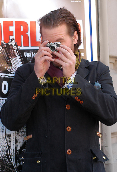 VAL KILMER.Wonderland photocall in Rome.18 February 2004.half length, half-length, camera, photographer.www.capitalpictures.com.sales@capitalpictures.com.© Capital Pictures.