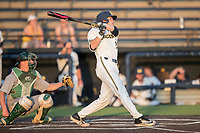 Michigan Wolverines pinch hitter Dominic Clementi (43) follows through on his swing during the NCAA baseball game against the Eastern Michigan Eagles on May 16, 2017 at Ray Fisher Stadium in Ann Arbor, Michigan. Michigan defeated Eastern Michigan 12-4. (Andrew Woolley/Four Seam Images)
