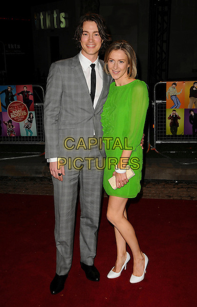 "TOM WISDOM.""The Boat That Rocked"" world film premiere at The Odeon, Leicester Square, London, England, UK,.23rd March 2009.full length grey gray suit checked black tie green dress guest sheer sleeves ruffle white shoes bracelet .CAP/CAS.©Bob Cass/Capital Pictures"