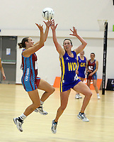 29.09.2014 Kapi Mana's Daya Wiffen and Dunedin's Stacey Peeters in action during the Dunedin v Kapi Mana match duing the Lion Foundation Netball Champs at the Trusts Stadium in Auckland. Mandatory Photo Credit ©Michael Bradley.