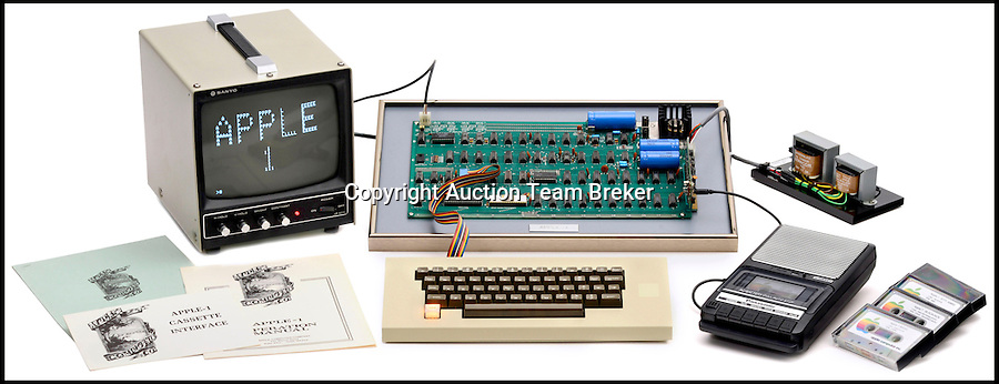 "BNPS.co.uk (01202 558833)<br /> Pic: ATBreker/BNPS<br /> <br /> Humble beginnings of a billion pound business... <br /> <br /> An incredibly rare Apple 1 computer, the 46th ever built and one of just a handful of Apple 1's in existence.<br /> <br /> Dubbed the ""world's best"" Apple 1, it has been put up for sale for £500,000.<br /> <br /> Included in the sale is a picture of the early production line in Steve Job's bedroom dating from 1976."