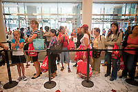 Shoppers at the JCPenney store in New York participate in a Paul Frank and Julius back-to-school promotion on Friday, August 13, 2010. JCPenney has cut its profit outlook for the rest of the year as retailers suffer as the economic recovery and the job market stall. In order to attract customers stores are adding more exclusive merchandise to differentiate themselves from their rivals. (© Richard B. Levine)