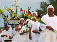 Woman walk in a procession to honor sea goddess Yemanja, the Yoruba goddess of the sea celebrated by devotees of Afro-Brazilian religions on Copacabana beach in Rio de Janeiro.(AustralFoto/Douglas Engle)