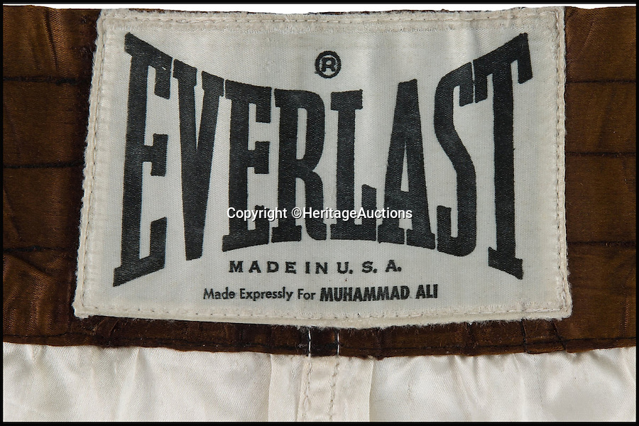 BNPS.co.uk (01202 558833)<br /> Pic: HeritageAuctions/BNPS<br /> <br /> Muhammad Ali's trunks from the fight have an estimate of £115,000.<br /> <br /> The iconic WBC Heavyweight Championship belt won by Muhammad Ali following the legendary Rumble in the Jungle in 1974.<br /> <br /> It is being sold by Heritage Auctions in September, with experts predicting the bids could reach as high as £1 million. <br /> <br /> Also included in the sale are the white satin trunks, valued at more than £100,000, worn by the late boxer during the historic contest, as well as the gloves he used to defeat Floyd Patterson in 1972.