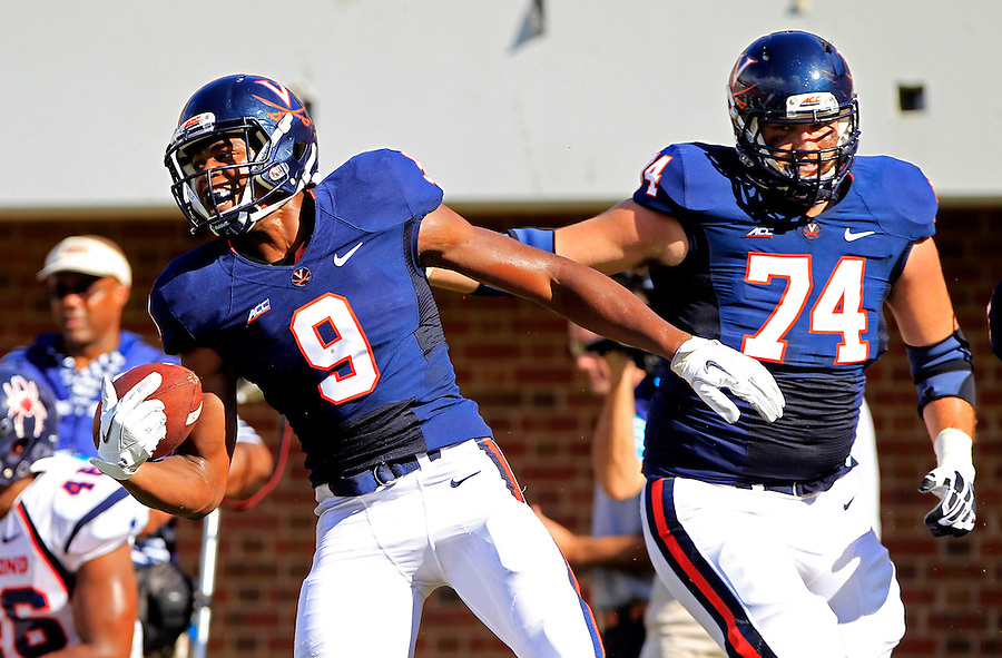 Virginia wide receiver Canaan Severin (9) celebrates a touchdown with Virginia guard Conner Davis (74) during the game Saturday Sept. 6, 2014 at Scott Stadium in Charlottesville, VA. Virginia defeated Richmond 45-13. Photo/Andrew Shurtleff