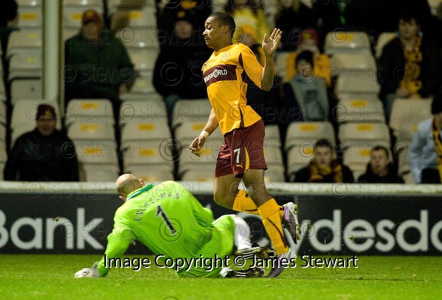 10/11/2010   Copyright  Pic : James Stewart.sct_jspa012_motherwell_v_st_johnstone  .:: PETER ENCKELMAN ESCAPES WITH A YELLOW CARD AFTER HIS LATE CHALLENGE ON CHRIS HUMPHREY   ::.James Stewart Photography 19 Carronlea Drive, Falkirk. FK2 8DN      Vat Reg No. 607 6932 25.Telephone      : +44 (0)1324 570291 .Mobile              : +44 (0)7721 416997.E-mail  :  jim@jspa.co.uk.If you require further information then contact Jim Stewart on any of the numbers above.........