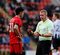 Referee, Lee Swabey warns Leyton Orient's Steve Alzate during the Sky Bet League 2 match between Leyton Orient and Grimsby Town at the Matchroom Stadium, London, England on 11 March 2017. Photo by Carlton Myrie / PRiME Media Images.