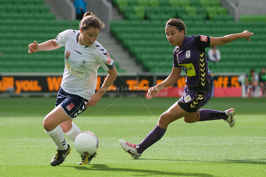 MELBOURNE, AUSTRALIA - DECEMBER 18: Samantha KERR of the Glory chases Kendall FLETCHER of the Victory during the round 7 W-League match between the Melbourne Victory and the Perth Glory at AAMI Park on December 18, 2010 in Melbourne, Australia. (Photo Sydney Low / asteriskimages.com)