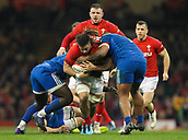 17th March 2018, Principality Stadium, Cardiff, Wales; NatWest Six Nations rugby, Wales versus France; Josh Navidi of Wales is tackled by Jefferson Poirot and Cedate Gomes Sa of France