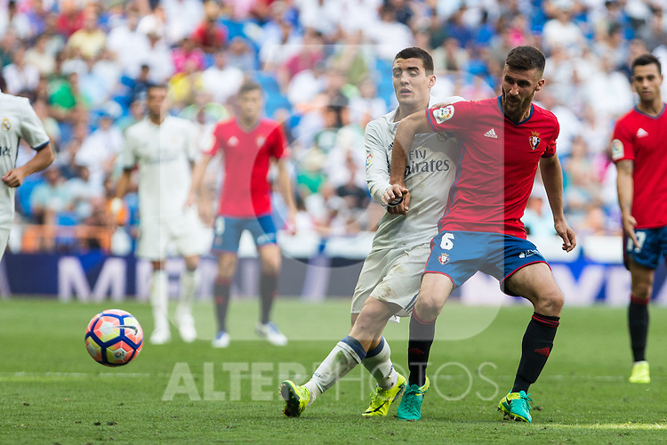 Real Madrid's Mateo Kovacic Club Atletico Osasuna's Oier Sanjurjo during the match of La Liga between Real Madrid and Club Atletico Osasuna at Santiago Bernabeu Estadium in Madrid. September 10, 2016. (ALTERPHOTOS/Rodrigo Jimenez)