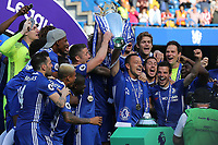 Chelsea's John Terry, holds the Premier League Trophy aloft and celebrates during Chelsea vs Sunderland AFC, Premier League Football at Stamford Bridge on 21st May 2017