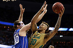 10 March 2016: Notre Dame's Zach Auguste (30) shoots over Duke's Marshall Plumlee (40). The University of Notre Dame Fighting Irish played the Duke University Blue Devils at the Verizon Center in Washington, DC in the Atlantic Coast Conference Men's Basketball Tournament quarterfinal and a 2015-16 NCAA Division I Men's Basketball game. Notre Dame won the game 84-79 in overtime.
