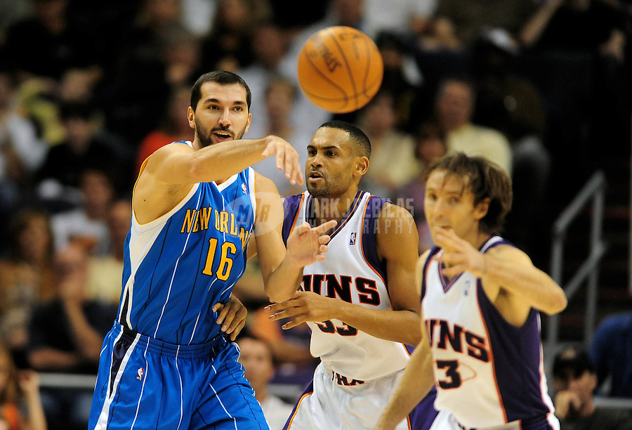 Nov. 11, 2009; Phoenix, AZ, USA; New Orleans Hornets forward (16) Peja Stojakovic passes the ball against the Phoenix Suns at the US Airways Center. Phoenix defeated New Orleans 124-104. Mandatory Credit: Mark J. Rebilas-