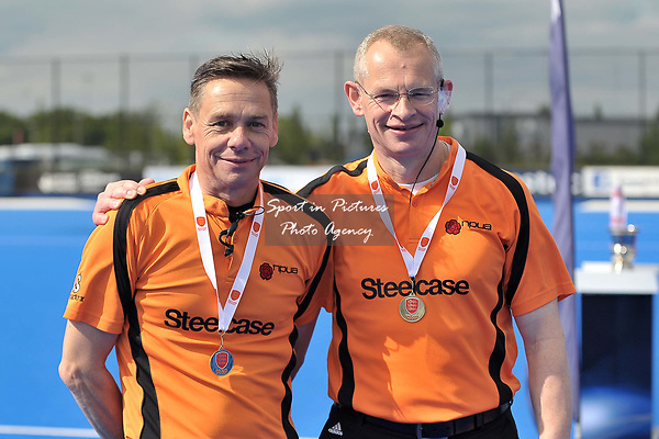 The umpires with their medals. Timperley v Formby (Men's Over 50's Trophy Final). Pitch 2. Men's Knockout Finals 2017. Lee Valley Hockey and Tennis Centre. London. UK. 29/04/2017. ~ MANDATORY CREDIT Garry Bowden/SIPPA - NO UNAUTHORISED USE - +44 7837 394578