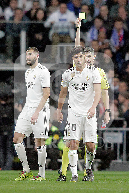 Referee Undiano Mallenci shows yellow card to Real Madrid CF's Marco Asensio  during La Liga match. March 02,2019. (ALTERPHOTOS/Alconada)