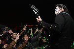 Chthonic Concert, Kaohsiung -- Guitarist Jesse Liu in front of a group of young Taiwanese fans.