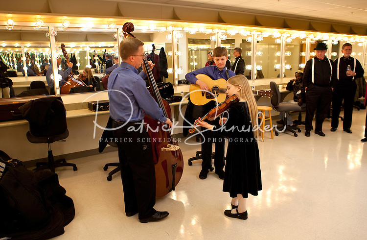 A family of young musicians warms up during the 20th year of the Tosco Music Party, held at the Overcash Academic and Performing Arts Center Dale F. Halton Theater Central Piedmont Community College. The annual event, named after John Tosco, owner of the Tosco Music Studio, is designed to showcase professional and amateur musicians.