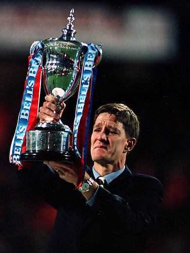 7TH MAY 1997, AN EMOTIONAL RICHARD GOUGH LIFTS THE SCOTTISH PREMIER LEAGUE TROPHY AS RANGERS RECORD THEIR NINTH TITLE IN A ROW, ROB CASEY PHOTOGRAPHY