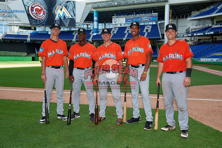 Miami Marlins Connor Scott (24), Osiris Johnson (11), Will Banfield (22), Tristan Pompey (20) and Nick Fortes (12) pose for a photo after a Florida Instructional League game against the Washington Nationals on September 26, 2018 at the Marlins Park in Miami, Florida.  (Mike Janes/Four Seam Images)