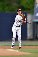 Asheville Tourists third baseman Matt McLaughlin (5) throws to first base during a game against the Greenville Drive at McCormick Field on May 22, 2018 in Asheville, North Carolina. The Tourists defeated the Drive 5-3. (Tony Farlow/Four Seam Images)
