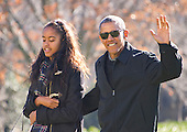 United States President Barack Obama waves to the assembled press as he walks with his daughter Malia on his family's return to the South Lawn of the White House in Washington, DC following their two week Hawaiian vacation on Sunday, January 3, 2016. <br /> Credit: Ron Sachs / Pool via CNP