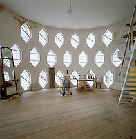 A sweeping view of the atelier with its floor-to-ceiling rows of hexagonal windows
