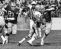 Seattle Seahawks Jim Zorn rushed by Oakland Raiders Ted Hendricks and John Matuszak. (1981 photo/Ron Riesterer)