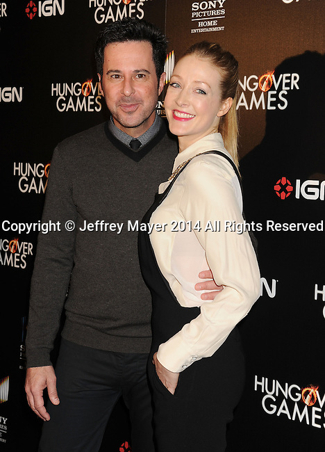 HOLLYWOOD, CA- FEBRUARY 11: Actress Jennifer Finnigan (R) and actor/husband Jonathan Silverman attend the Los Angeles Premiere of 'The Hungover Games' at TCL Chinese Theatre on February 11, 2014 in Hollywood, California.