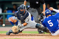 West Michigan Whitecaps catcher Adolfo Reina (20) waits for the throw as Malcolm Holland (5) of the Great Lakes Loons slides into home plate at the Dow Diamond on June 11, 2013 in Midland, Michigan.  The Loons defeated the Whitecaps 13-6.  (Brian Westerholt/Four Seam Images)