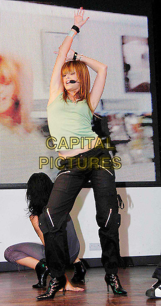 HOLLY VALANCE.live at HMV Oxford Street.music, concert, dancing, singing, gig, green vest.www.capitalpictures.com.sales@capitalpictures.com.©Capital Pictures