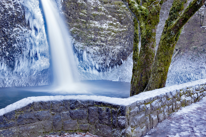 Lower Horsetail Falls with ice and rock wall. Columbia River Gorge National Scenic Area. Oregon