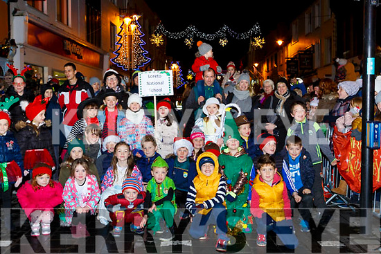 Loreto NS pupils marching in the Kiilarney Christmas parade through the packed streets  on Saturday night