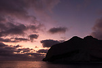 San Benedicto Island, Revillagigedos Islands, Mexico; the Sleeping Lady rock formation at the southern end of San Benedicto island, silhouette by sunset cloud formations