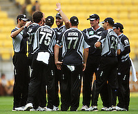 Black Caps captain Daniel Vettori high-fives bowler Kyle Mills after the dismissal of Yuvraj Singh during the 2nd ODI cricket match between the New Zealand Black Caps and India at Westpac Stadium, Wellington, New Zealand on Friday, 6 March 2009. Photo: Dave Lintott / lintottphoto.co.nz