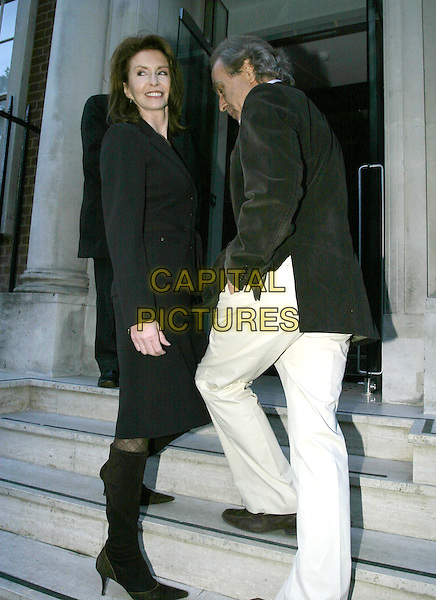 "JANE ASHER & GUEST.""Maze"" Restaurant Launch Party, Maze, London Marriott Hotel, Grosvenor Square, London, .May 24th 2005..full length steps.Ref: AH.www.capitalpictures.com.sales@capitalpictures.com.©Adam Houghton/Capital Pictures."