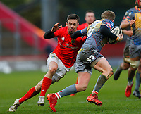 29th February 2020; Thomond Park, Limerick, Munster, Ireland; Guinness Pro 14 Rugby, Munster versus Scarlets; Darren Sweetnam of Munster attempts to tackle Angus O'Brien of Scarlets