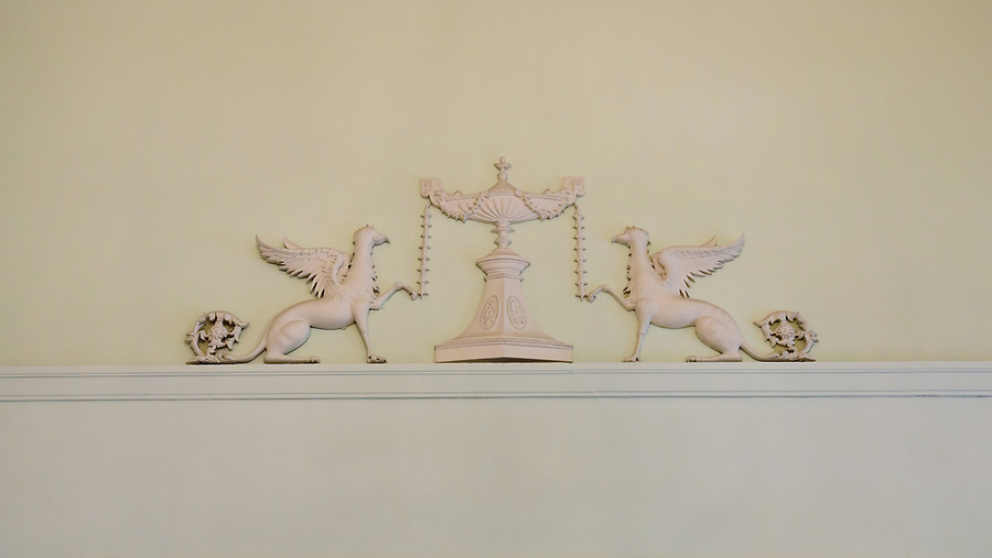 This decoration appears at each end of the Drawing Room, high up on the wall.