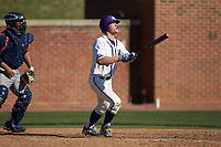 Jordan Sergent (9) of the High Point Panthers watches the flight of his 2-run home run in the bottom of the sixth inning against the NJIT Highlanders at Williard Stadium on February 19, 2017 in High Point, North Carolina. The Panthers defeated the Highlanders 6-5. (Brian Westerholt/Four Seam Images)