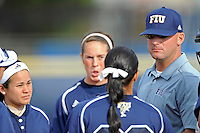 11 February 2012:  FIU Head Coach Jake Schumann speaks with his players as the University of Massachusetts Minutewomen defeated the FIU Golden Panthers, 3-1, as part of the COMBAT Classic Tournament at the FIU Softball Complex in Miami, Florida.