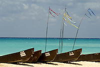 Traditional Mayan dugout canoes lined up on the beach at Playa del Carmen or Xamanha, Sacred Mayan Journey 2011 event, Riviera Maya, Quintana Roo, Mexico.