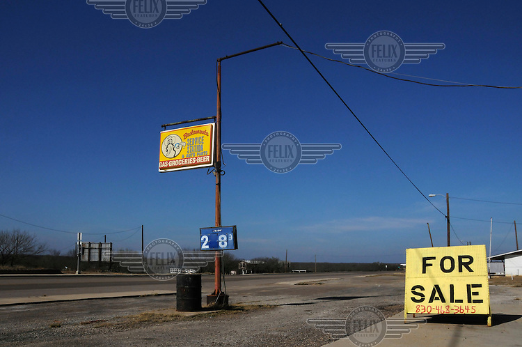 A 'for sale' sign outside a petrol station in Carrizo Springs, Texas, on route 277.