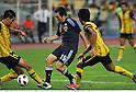 (L-R) Mohammad Amer bin Saidin (MAS), Manabu Saito (JPN), Mohd Affize Faisal Bin Mamat (MAS),.FEBRUARY 22, 2012 - Football / Soccer :.2012 London Olympics Asian Qualifiers Final Round Group C match between U-23 Malaysia 0-4 U-23 Japan at National Stadium Bukit Jalil in Kuala Lumpur, Malaysia. (Photo by Takamoto Tokuhara/AFLO)