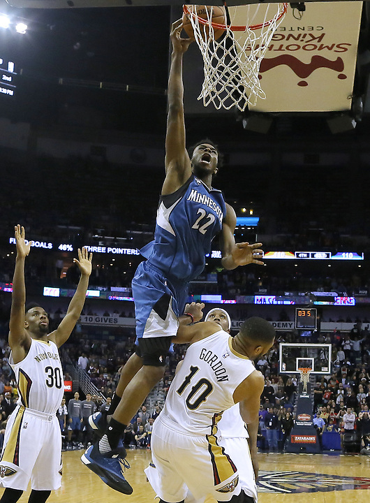 Minnesota Timberwolves guard Andrew Wiggins (22) is fouled by New Orleans Pelicans guard Eric Gordon (10) in the final seconds of an NBA basketball game Saturday, Feb. 27, 2016, in New Orleans. Wiggins went on to complete both free throws putting the Timberwolves up by two points with 3.6 seconds left in the game. The Timberwolves won 112-110.  (AP Photo/Jonathan Bachman)