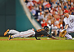 18 May 2012: Baltimore Orioles outfielder Xavier Avery dives safely back to first during a game against the Washington Nationals at Nationals Park in Washington, DC. The Orioles defeated the Nationals 2-1 in the first game of their 3-game series. Mandatory Credit: Ed Wolfstein Photo