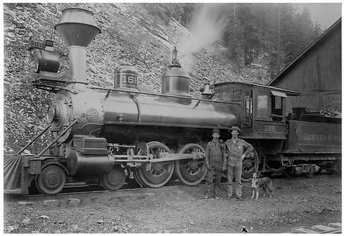 Engine #168 in front of engine house with crew and mascot.<br /> D&amp;RG  Ouray, CO
