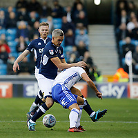 Steve Morison of Millwall gets to grips with Maxime Colin of Birmingham City during the Sky Bet Championship match between Millwall and Birmingham City at The Den, London, England on 21 October 2017. Photo by Carlton Myrie.